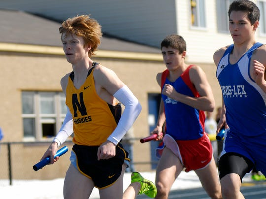 Port Huron Northern junior, Brad Mallory starts his leg of the 3,200-meter relay during the 2014 Husky Relays at Port Huron Northern High School.