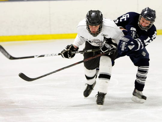 Countless youths have competed in hockey games at Lakeshore Hockey Arena, including this 2010 matchup between Greece's Kendrick Heintzelman, left, and Gates Chili's Jake Mattiole.