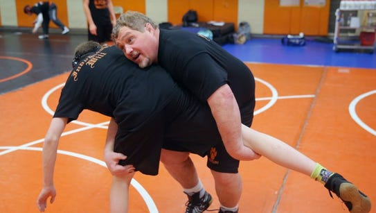 Central Kitsap wrestling coach Mike Harter and the