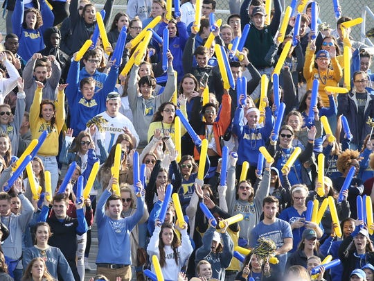 Delaware student fans cheer their team in the second