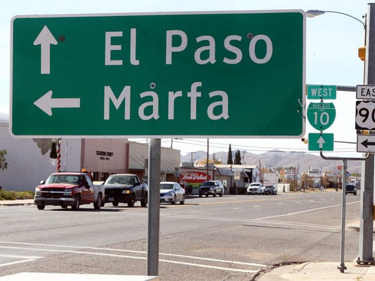 A sign along the main street in Van Horn, Texas, points the way toward El Paso on Wednesday.