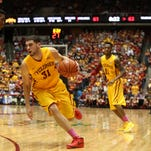 Iowa State junior Georges Niang drives the lane against Kansas State's Wesley Iwundu on Tuesday, Jan. 20, 2015, at Hilton Coliseum in Ames, Iowa.