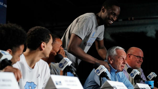 North Carolina's Theo Pinson rubs the shoulders of head coach Roy Williams during a college basketball news conference, Saturday, March 26, 2016, in Philadelphia. North Carolina will play Notre Dame on Sunday in the regional finals of the men's NCAA Tournament. (AP Photo/Matt Rourke)
