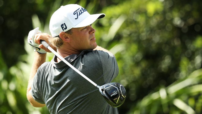 Patton Kizzire of the United States plays his shot from the 18th tee during the first round of the OHL Classic at Mayakoba.