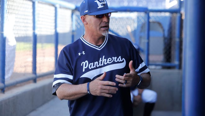 Piedra Vista baseball coach Mike McGaha talks to his team after its 3-0 district win over Volcano Vista Tuesday at Ricketts Park. PV will be the No. 3 seed in the 6A bracket.
