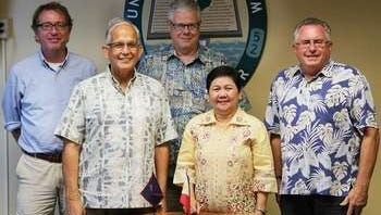 University collaboration -- From left: Dr. Terry Donaldson, Director of UOG Marine Lab; Dr. Robert Underwood, UOG President; John Peterson, UOG Assistant Vice President of Graduate Studies Research and Sponsored Programs; Dr. Elsa Palao-Manarpaac, President of the Western Philippines University; and Lee Yudin, Dean of the College of Natural and Applied Sciences.
