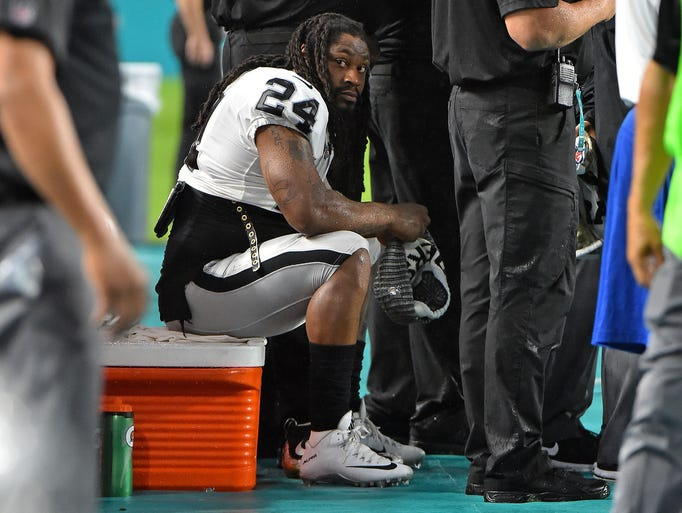 Oakland Raiders running back Marshawn Lynch sits on