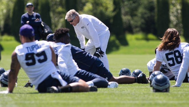 Head coach Pete Carroll talks to players as they stretch during the first day of the Seattle Seahawks NFL football rookie minicamp on Friday, May 6, 2016 at Virginia Mason Athletic Center in Renton, Wash.