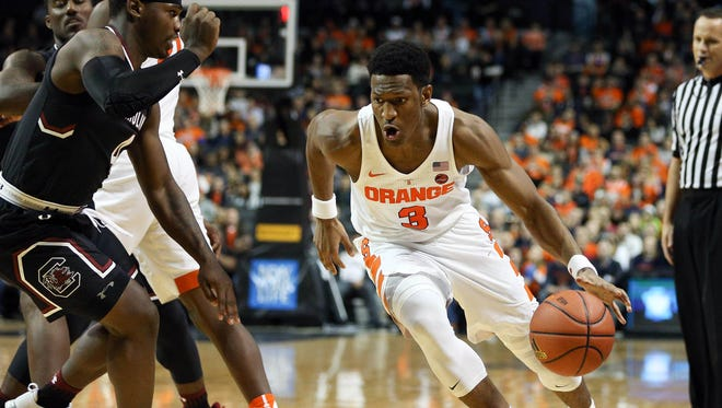 Syracuse guard Andrew White III, right, the graduate transfer from Nebraska, is averaging 14.8 points, tops on the team.