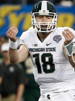 Michigan State quarterback Connor Cook (18).