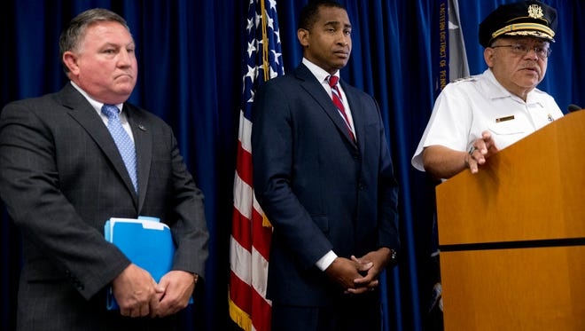 Philadelphia Police Commissioner Charles Ramsey, right, speaks as FBI Special Agent-in-Charge Edward Hanko, left, and United States Attorney Zane David Memeger, center, listen during a news conference Wednesday, July 30, 2014, in Philadelphia. Six Philadelphia narcotics officers have been indicted on charges they spent years shaking down drug dealers, using gangland tactics to rob them of cash and drugs, federal prosecutors announced Wednesday. (AP Photo/Matt Rourke)