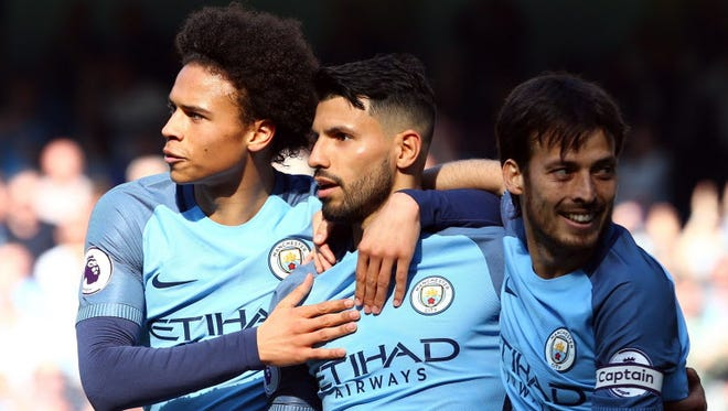 Manchester City's Sergio Agüero (center) celebrates his goal with teammates Leroy Sané (left) and David Silva.