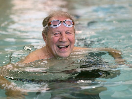 Sonny Veltre, 87, gets in some exercise after his shift as a lifeguard at the Northwest Family YMCA in Greece.