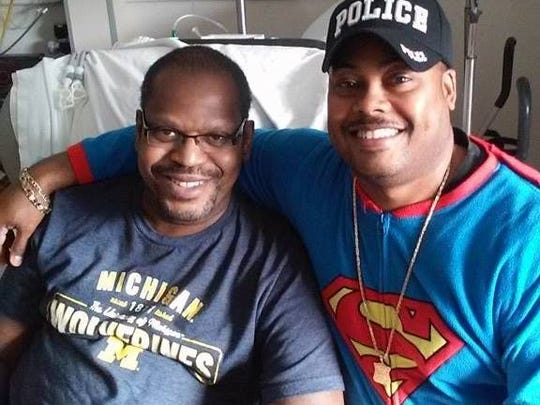 Officer Sidney Taylor and Office Mark Wallace of the Detroit police.