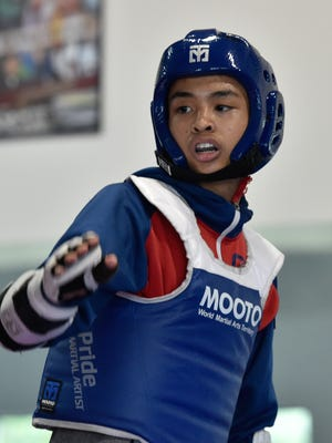 Salesianum sophomore Miguell Sanchez from Camden, one of nation's top junior Olympic Sparring (Taekwondo) competitors practices with Marcus Munday of Felton at Kaizen Karate Academy in Dover.