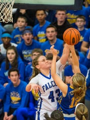 Cedar Crest's Alyssa Austin blocks the shot of Northern