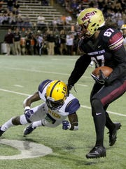 Midwestern State's Dorian Johnson tries to stiff arm