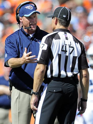 Titans coach Ken Whisenhunt argues a call with line judge Tim Podraza during the third quarter.