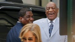 Bill Cosby laughs as he arrives at the Montgomery County