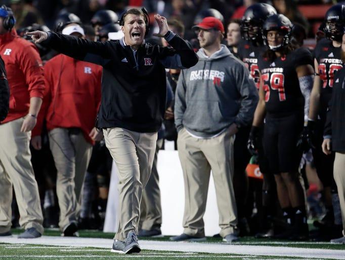 Rutgers head coach Chris Ash shouts at an official