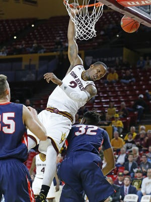 Arizona State Sun Devils forward Willie Atwood (2) is fouled by Belmont Bruins forward Amanze Egekeze (32) during the first half of their NCAA basketball game Monday, Nov. 16, 2015 in Tempe, Ariz.