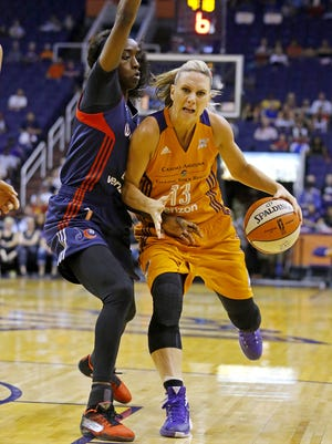 Phoenix Mercury forward Penny Taylor (13) tries to get past Washington Mystics forward Kahleah Copper (2) during the first half of their WNBA game Sunday, May 29, 2016 in Phoenix, Ariz.