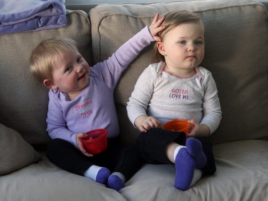 17-month-old Vivian Dumpert and her twin sister Evelyn. Vivian was born with a congenital heart defect. While doctors told her parents she would likely die before being born, sheÕs continued to beat the odds through several open heart surgeries.  February 10, 2017, Landing, NJ.