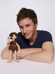 Dug and Eddie Redmayne pose together for 'Early Man.'