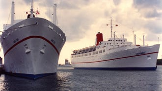 The Mardi Gras (left) may have been the first Carnival ship but it was the Carnivale (right) that established the line as a cruise industry powerhouse.  Both are shown at Port Canaveral prior to their departure from the Carnival fleet in late 1993.