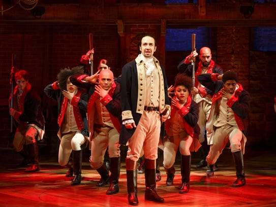 Lin-Manuel Miranda, foreground, with the cast during