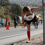 Cory Wagner stretches before running the Horsetooth Half Marathon on April 19, 2015.