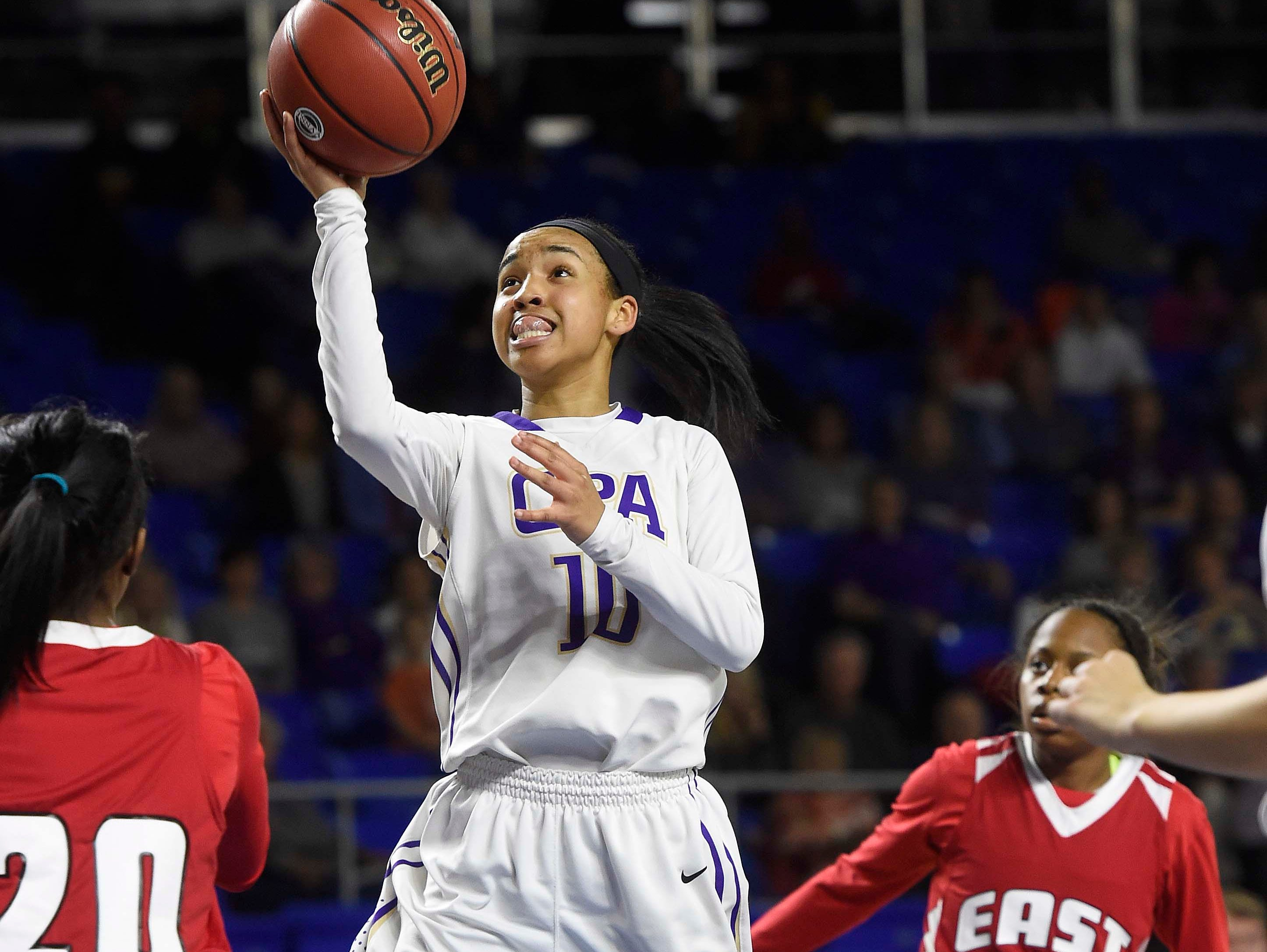CPA's Kenedi Hambrick (10) drives the lane as East Nashville leads 25-24 at the half n the Division I Class AA Girl's basketball tournament at the Murphy Center on MTSU's campus March 10, 2016 in Murfreesboro, Tenn.