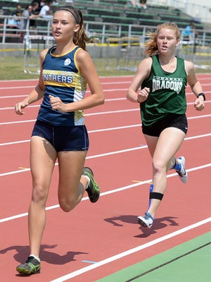 Guam High senior Emma Sheedy holds a brief lead over Kubasaki's Elizabeth Joy in the 1,600-meter run during Friday's Mike Petty Memorial Track and Field Meet at Kubasaki High School on Okinawa. Sheedy took second in that event and also finished third in the 400 meters and fourth in the 800 meters in her first competition of the season, and also her first competition against DODEA Pacific athletes.