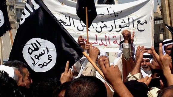 Demonstrators chant for ISIS as they wave al-Qaida