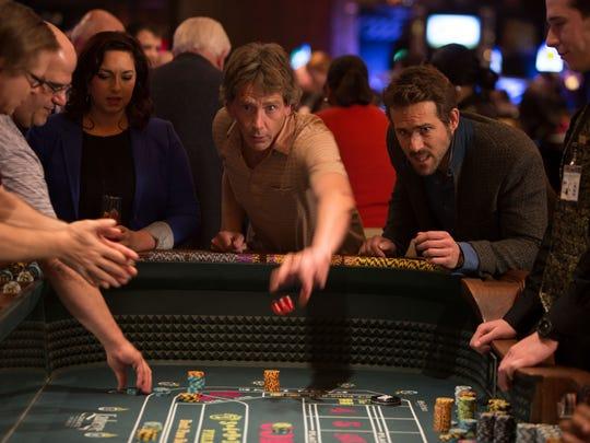 Ben Mendelsohn, left, and Ryan Reynolds in a scene