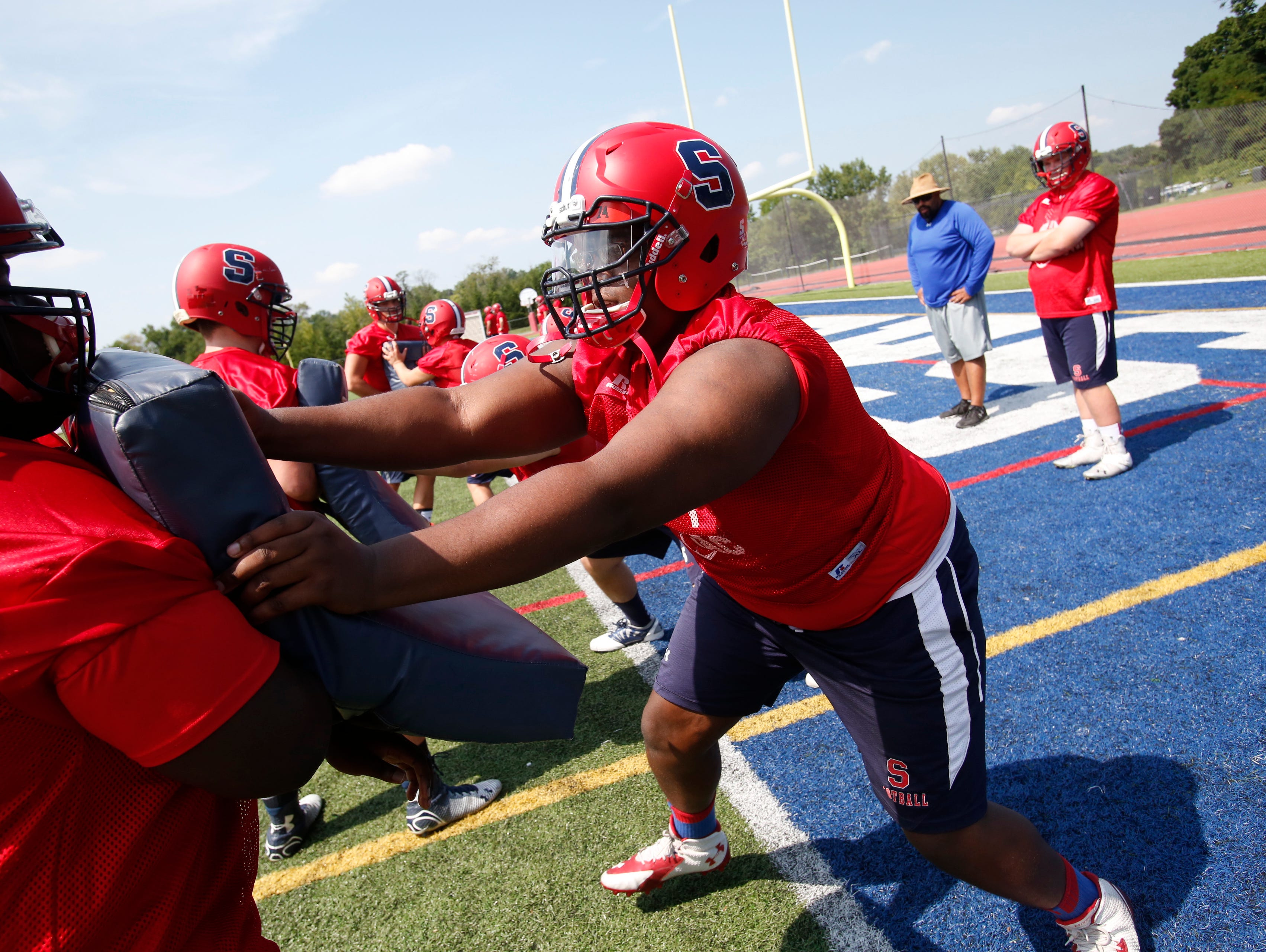 Archbishop Stepinac High School Football's OT David Harris goes through some drills during practice in White Plains on Aug. 24, 2015.