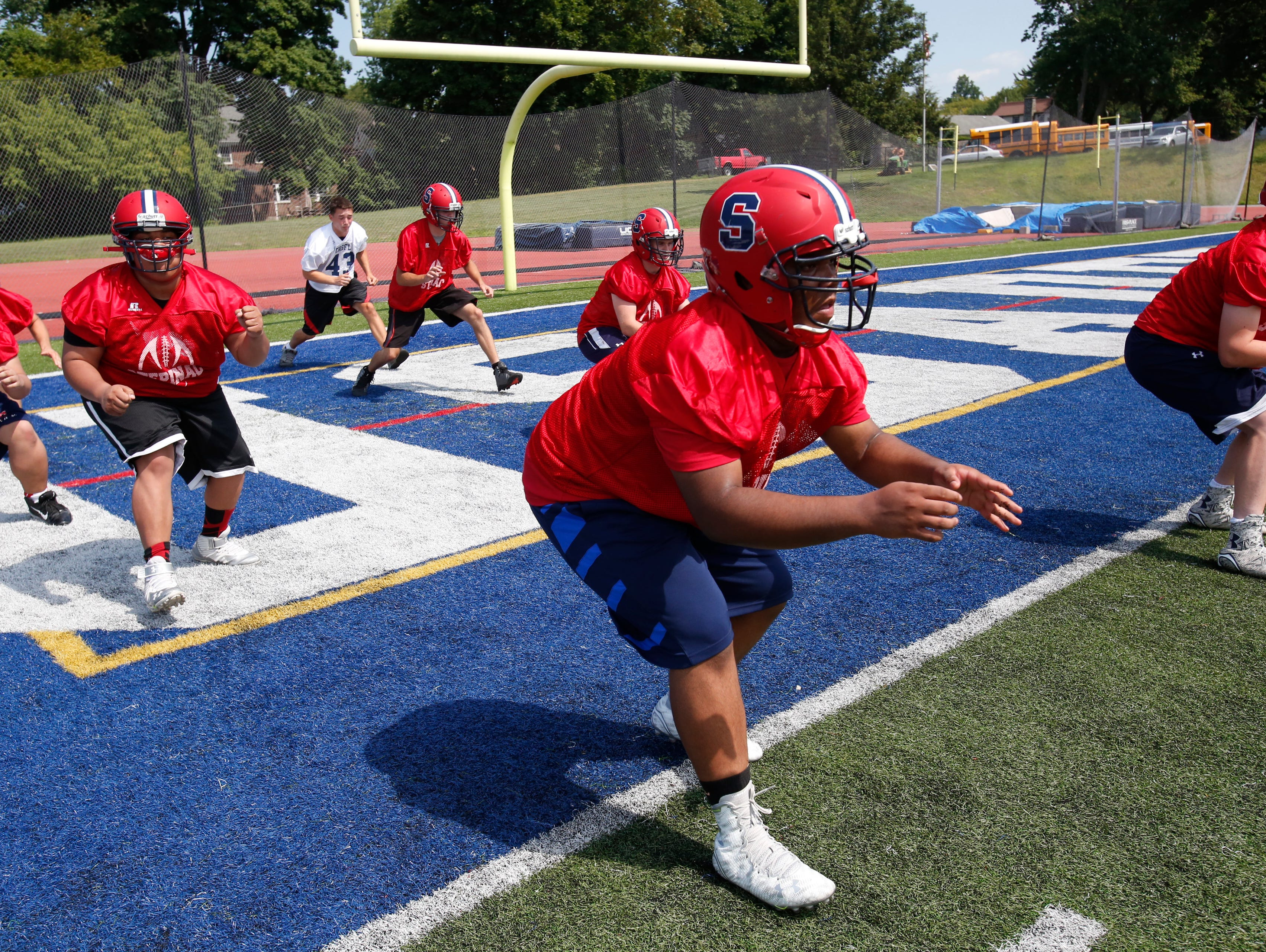 Archbishop Stepinac High School Football team go through drills during practice in White Plains on Aug. 24, 2015.