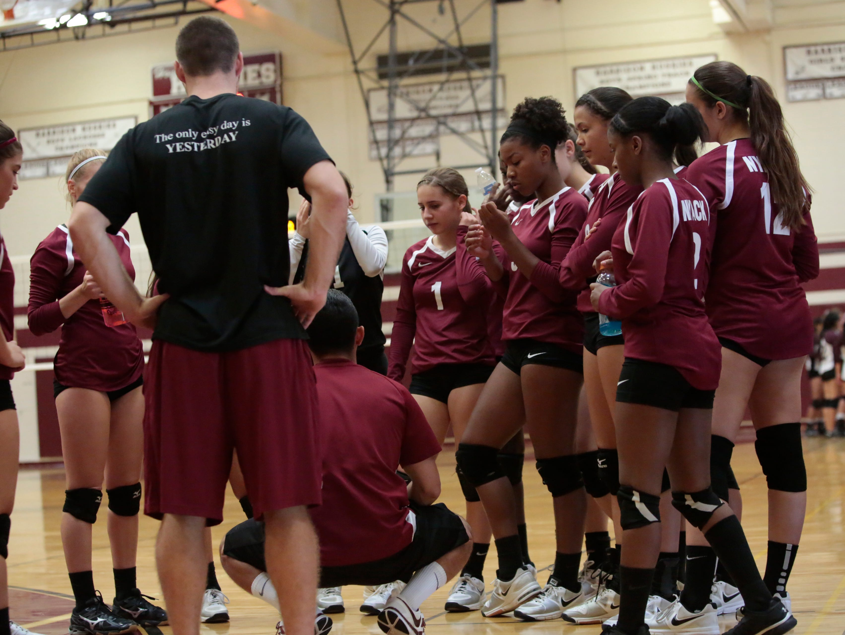 Game action between Harrison and Nyack volleyball at Harrison High School on Sept. 28, 2015.
