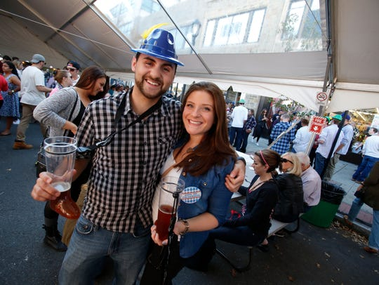 A couple poses for a picture at the White Plains Octoberfest