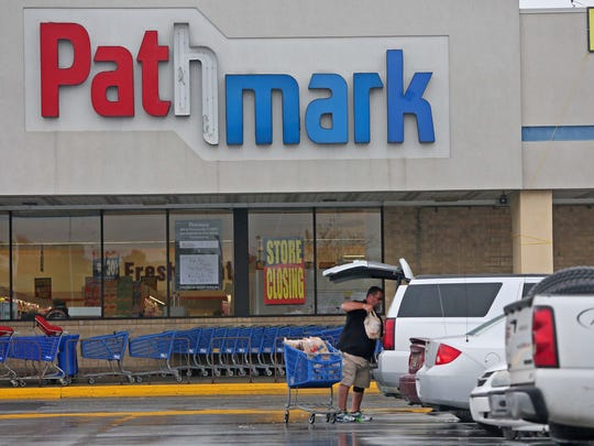 James Johnson, a loyal customer of Pathmark, unloads groceries after shopping at the Airport Plaza shopping center off North Du Pont Highway (U.S. 13), near New Castle. The store closed in 2015.
