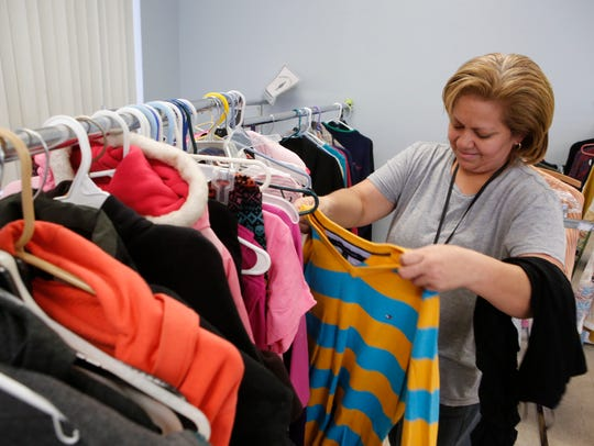 Jeannette Meneses of Spring Valley looks through clothing