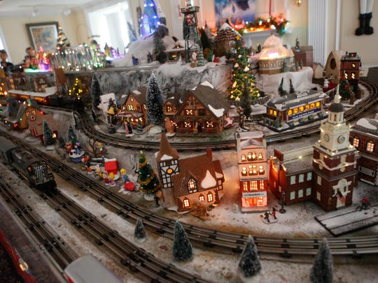 Families enjoy the train display at the Holiday on the Hill train show at the Lasdon Arboretum in Katonah on Dec. 13, 2015.