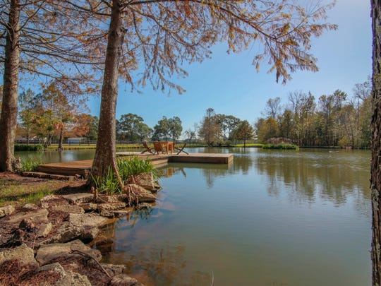 The property includes 55 acres of manicured grounds and stocked ponds.