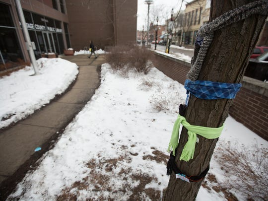 Scarves are tied to a tree in front of the Portage County Library in downtown Stevens Point, Monday, Jan. 25, 2016. Local Girl Scouts are working with the Evergreen Community Initiative to create scarves to give away to those in need by tying the scarves to trees around Stevens Point.