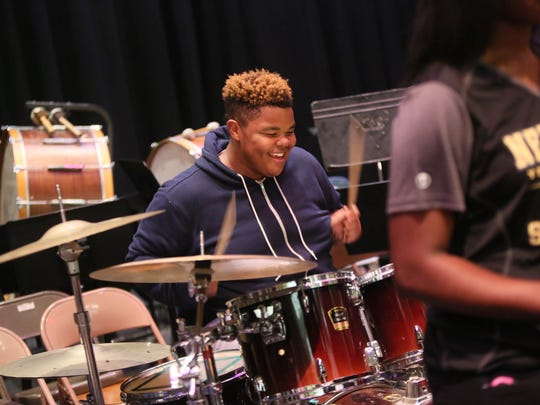 Christopher Gibbs, a junior at Glasgow High School, plays drums with band students from school in the Christina School District during practice for the upcoming big band concert on Friday. The district is one of three planning upcoming referendums.