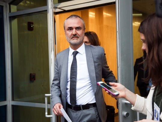 Gawker founder Nick Denton walks out of the courthouse