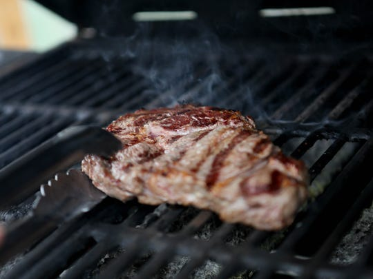 Head chef and kitchen manager Megan Bushnell demonstrates how to grill an organic Delmonico steak at Harvest Market.
