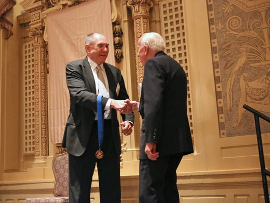 """Executive Editor of the News Journal David Ledford greets 92 year-old Paul Collins, member of the Society of St. Vincent de Paul, after he was honored with the """"Outstanding Service Benefiting Local Communities"""" at the Jefferson Awards Foundations Salute to Service ceremony at the Hotel du Pont in April 2016."""