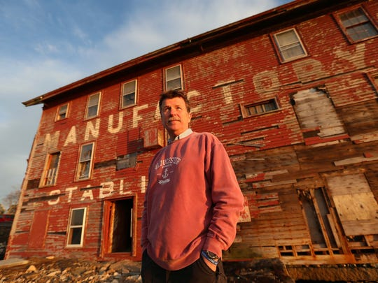 Angel Program volunteer George Hackford outside of a factory that manufactured paint for fishing boats out of Gloucester, Mass.