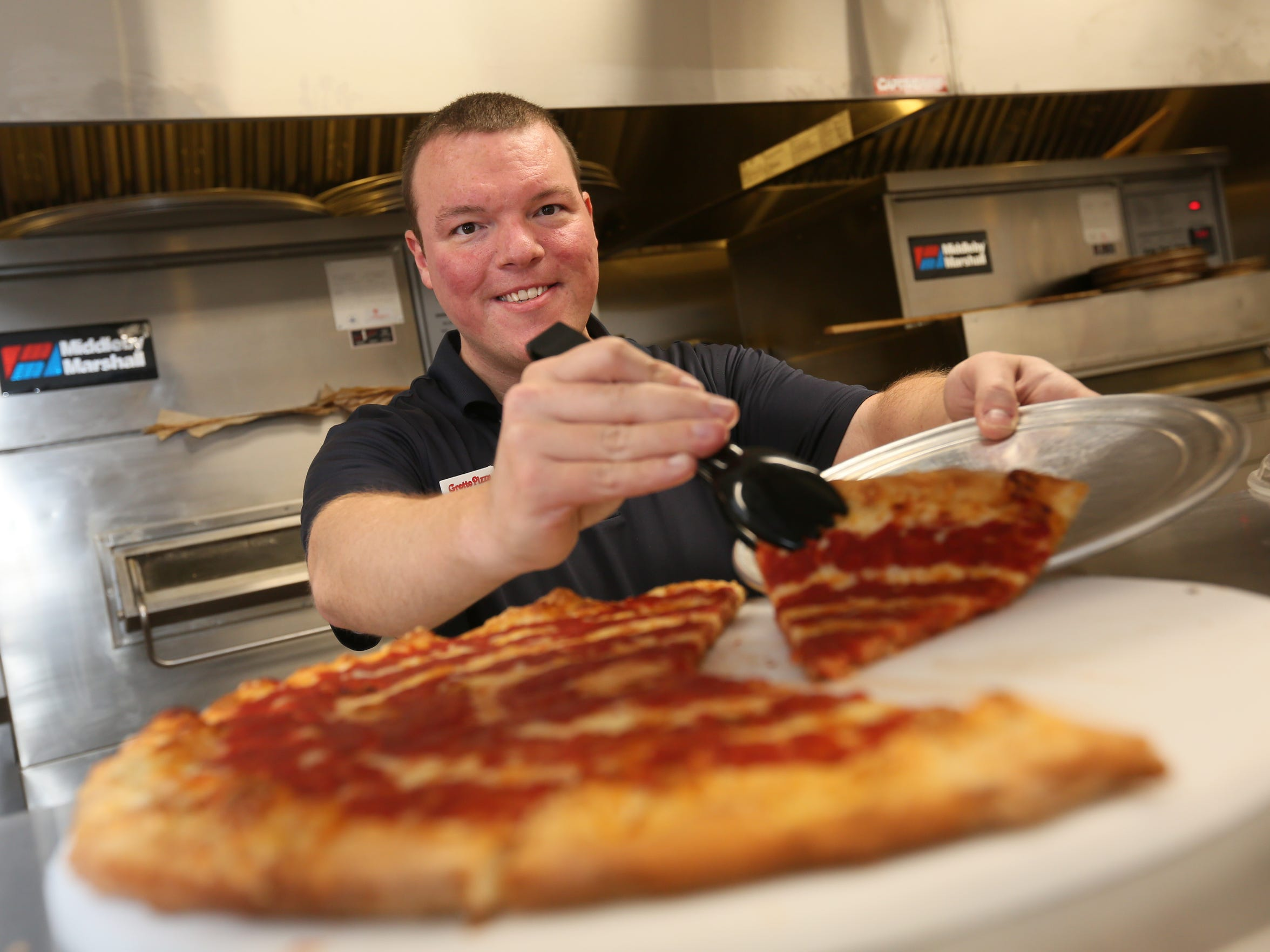 Jordan Whaley, a 33-year-old assistant manager for Grotto Pizza in Middletown, averages about 50 hours a week. Grotto Pizza and other businesses are facing some tough choices about how to handle middle managers in light of the Obama administration's new overtime rules.